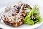 Juicy pork steaks with a simple green salad
