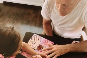 Adorable photo alert! Bruce Willis lets daughter practice nail art on him