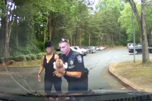 Watch: baby choking after a bottle is saved by a police officer