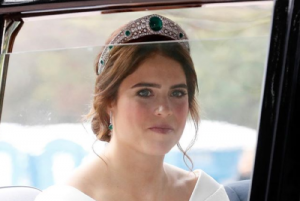 Here comes the bride: Princess Eugenie looks flawless in Peter Pilottogown