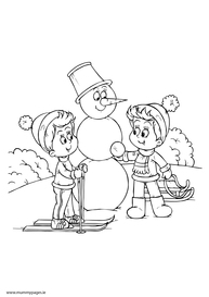 Boys building snowman