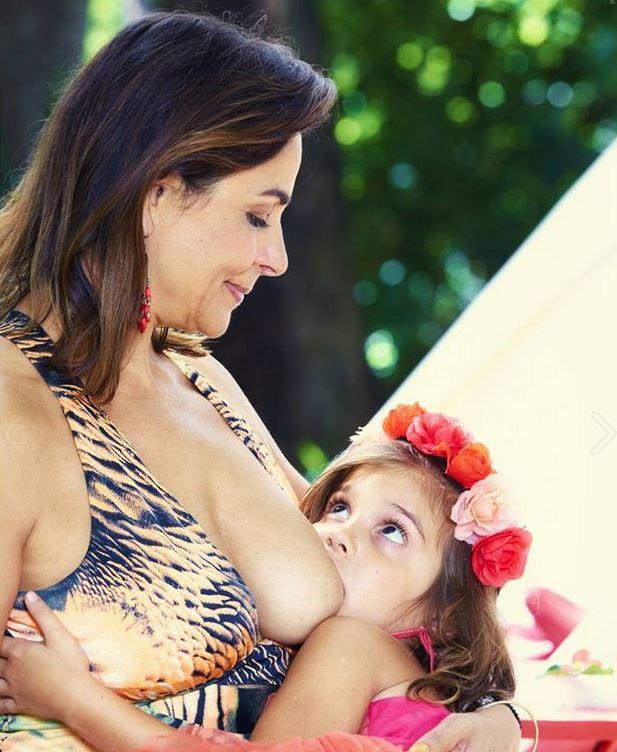 Mother Breastfeeding Daughter