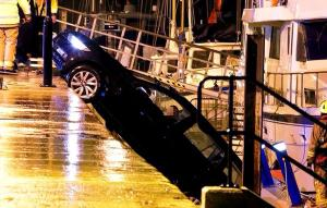 Pregnant woman rescued from car after accidentally reversing over the edge