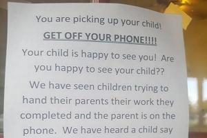 Get off your phone Not everyone is impressed with this daycares note