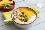 Mango and pineapple smoothie bowl