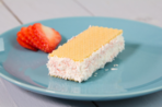 Coconut and strawberry ice cream sandwich