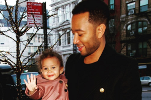 This video of Chrissy Teigen and John Legend with Luna at the Rockettes will melt any Grinchs heart